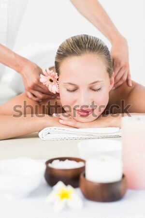 Masseuse pourring massage oil on a young woman's back in a spa Stock photo © wavebreak_media