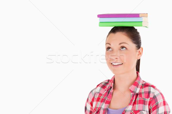 Atrakcyjna kobieta książek głowie stałego biały Zdjęcia stock © wavebreak_media
