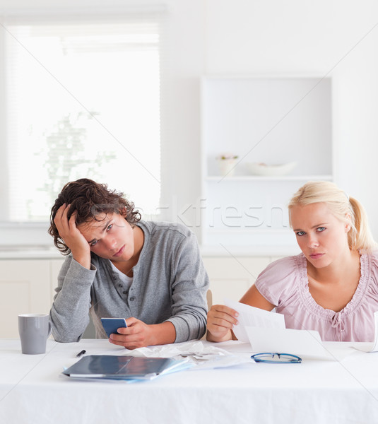 Cute despaired couple doing accounts Stock photo © wavebreak_media
