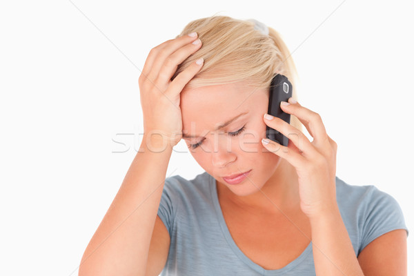 Sad blond woman on a phone in a studio Stock photo © wavebreak_media