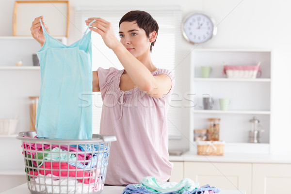 Woman folding clothes in a utility room Stock photo © wavebreak_media
