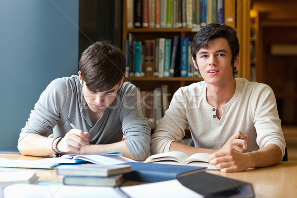 Handsome student reviewing their notes in a library Stock photo © wavebreak_media