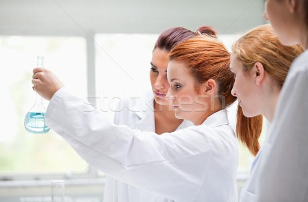 Aranyos kémia diákok tart flaska laboratórium Stock fotó © wavebreak_media