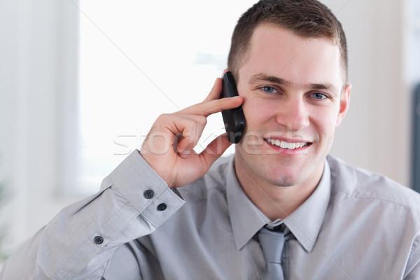 Souriant jeunes affaires bonnes nouvelles téléphone affaires Photo stock © wavebreak_media