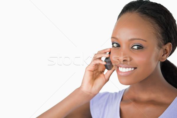 Lächelnde Frau Telefon weiß Hintergrund Kommunikation Stock foto © wavebreak_media