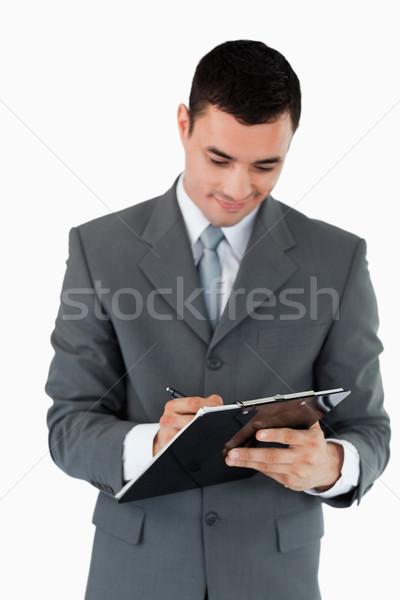 Affaires prendre des notes presse-papiers blanche papier stylo Photo stock © wavebreak_media