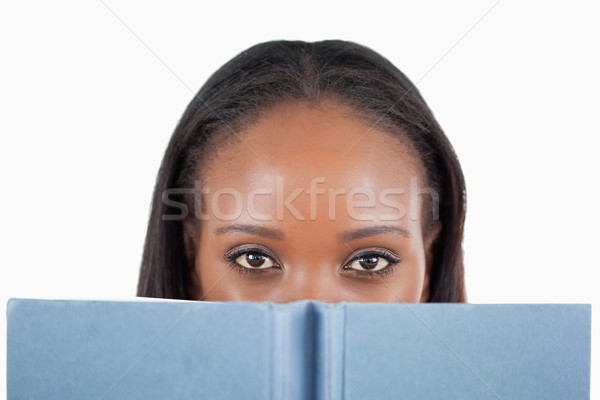 Young woman behind her book against a white background Stock photo © wavebreak_media