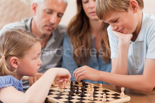 Közelkép testvérek játszik sakk szülők nappali Stock fotó © wavebreak_media