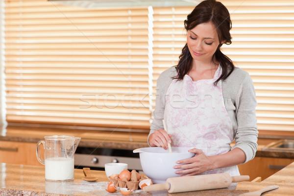 Happy woman baking in her kitchen Stock photo © wavebreak_media
