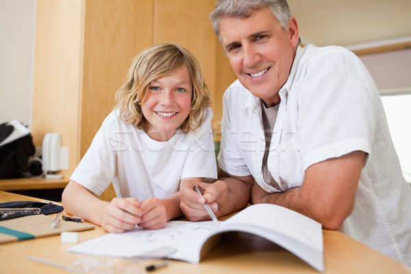 Father helping his son with his homework Stock photo © wavebreak_media
