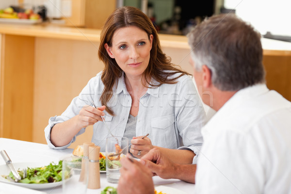 Woman talking to her husband during dinner Stock photo © wavebreak_media