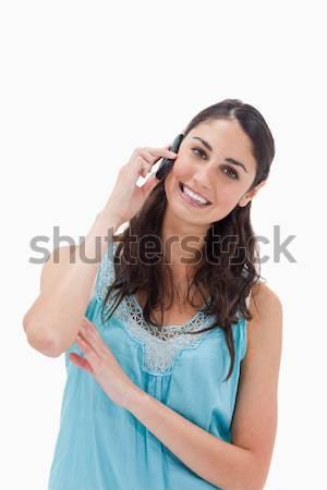 Portré nő készít telefonbeszélgetés fehér mosoly Stock fotó © wavebreak_media