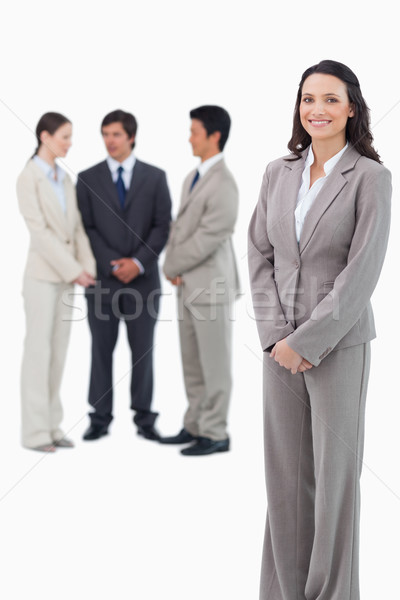 Glimlachend verkoopster team achter witte business Stockfoto © wavebreak_media