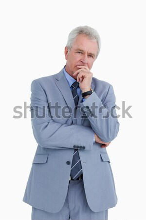 Mature tradesman in thinkers pose against a white background Stock photo © wavebreak_media