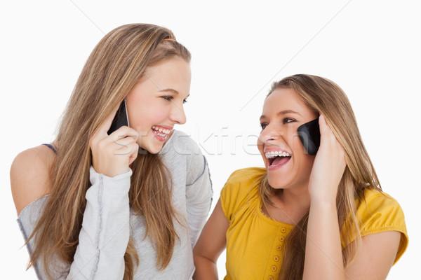 два смеясь телефон белый Сток-фото © wavebreak_media