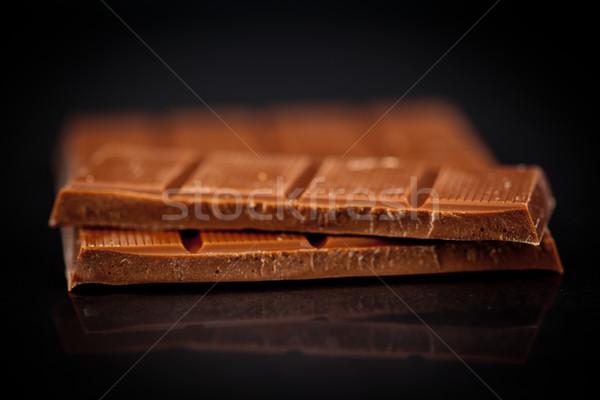 Zamazany bar czekolady czarny tle Zdjęcia stock © wavebreak_media