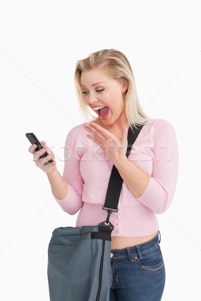 Boldog nő mutat meglepetés olvas szöveg Stock fotó © wavebreak_media
