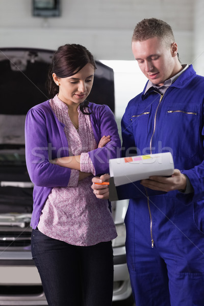 Mechanic showing the quotation to a woman in a garage Stock photo © wavebreak_media