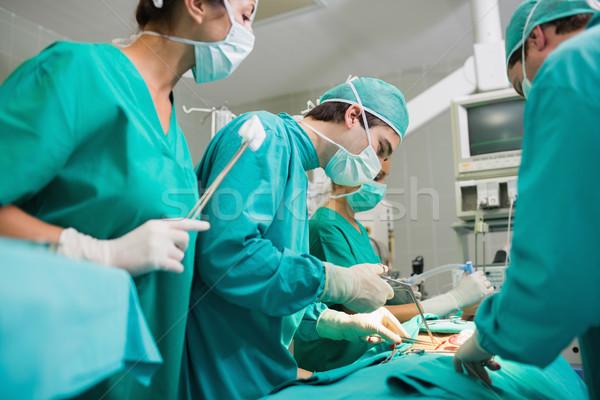 Cirurgião cirúrgico ferramenta teatro hospital monitor Foto stock © wavebreak_media