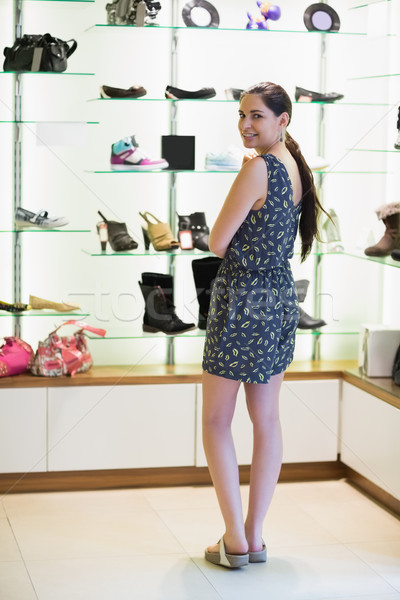 Woman standing at shoe display in shopping mall Stock photo © wavebreak_media