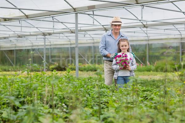 Jardinier petit-enfant fleur effet de serre famille Photo stock © wavebreak_media
