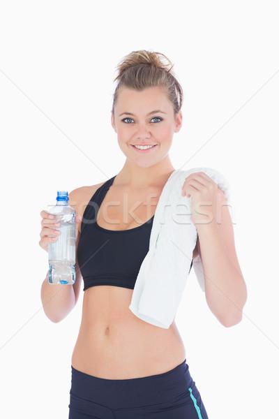 Nő áll tart üveg törölköző mosolyog Stock fotó © wavebreak_media