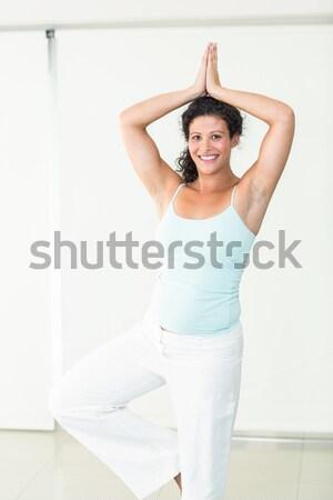Smiling girl sitting in lotus yoga pose Stock photo © wavebreak_media
