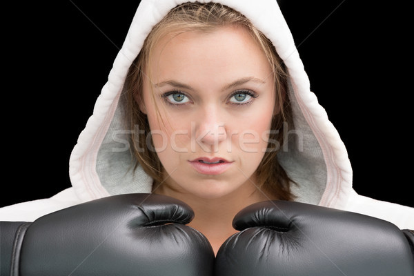 Serious woman wearing boxing gloves and robe Stock photo © wavebreak_media