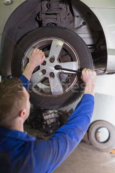 Mechanic fixing car wheel Stock photo © wavebreak_media