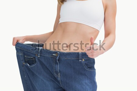 Midsection of woman wearing old pants after losing weight and ge Stock photo © wavebreak_media