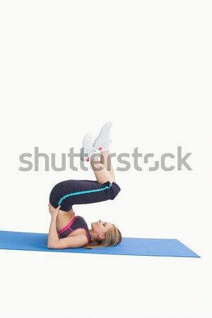 Side view of young woman in the shoulder stand position on yoga  Stock photo © wavebreak_media