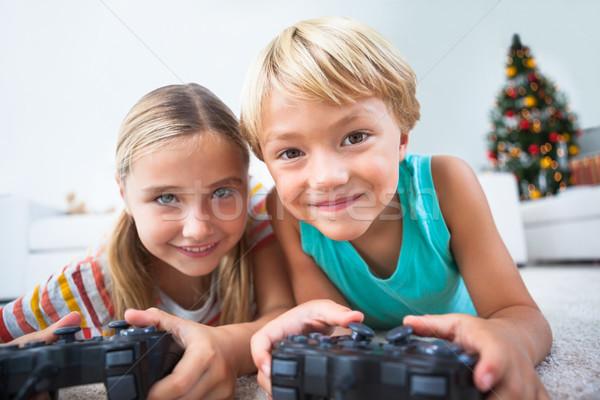 Feliz irmãos jogar piso natal Foto stock © wavebreak_media