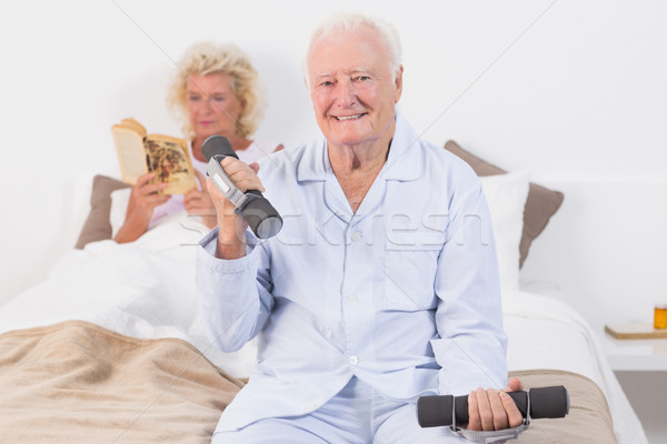 Elderly man lifting hand weights Stock photo © wavebreak_media