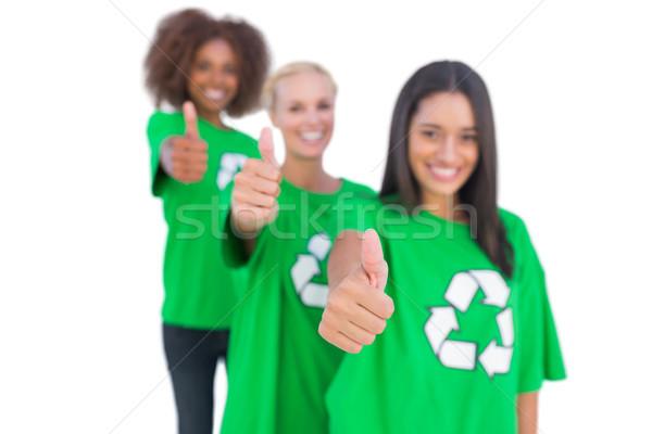 Three smiling enviromental activists giving thumbs up Stock photo © wavebreak_media