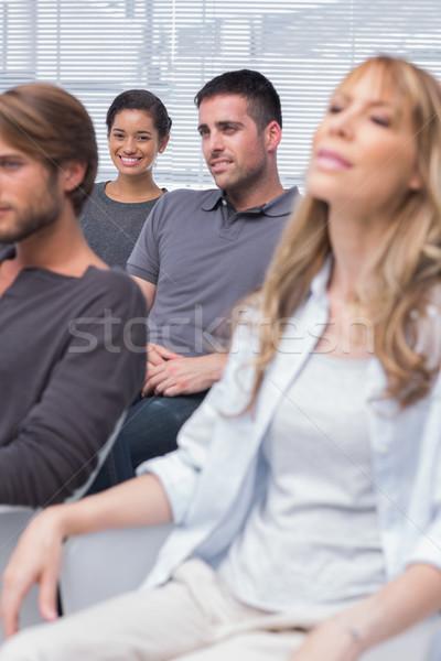 Hallgat csoport terápia egy lány mosolyog kamera Stock fotó © wavebreak_media