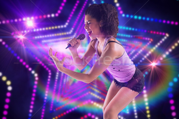 Imagem bastante menina cantando digitalmente Foto stock © wavebreak_media