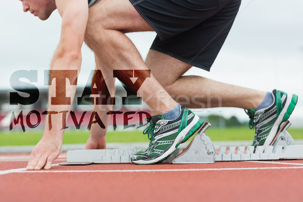 Composite image of side view of a man ready to race on running t Stock photo © wavebreak_media