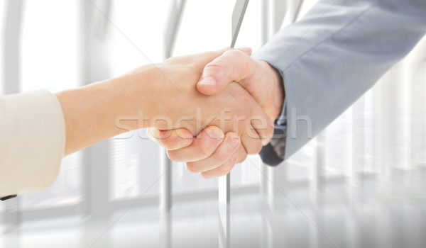 Composite image of closeup of shaking hands after business meeti Stock photo © wavebreak_media