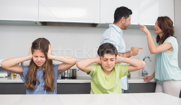 Sad young kids while parents quarreling Stock photo © wavebreak_media