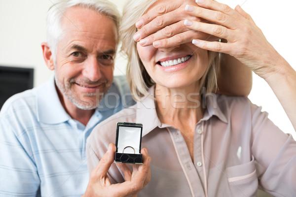 Smiling man surprising woman with a wedding ring Stock photo © wavebreak_media
