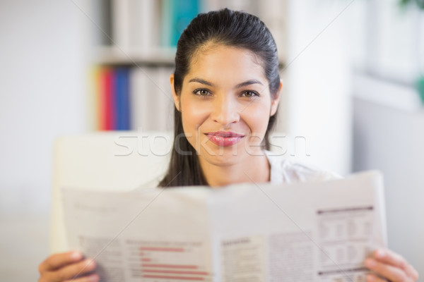 Stock photo: Portrait of businesswoman reading newspaper