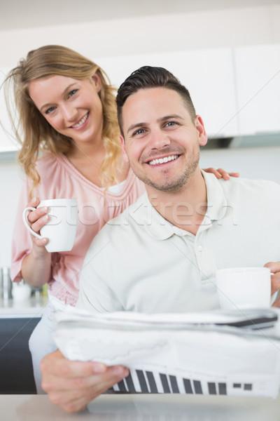 Coppia caffè giornale cucina ritratto felice Foto d'archivio © wavebreak_media