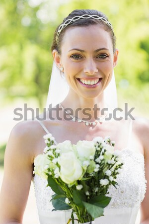 Smiling beautiful bride with bouquet against clear sky Stock photo © wavebreak_media