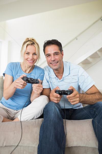 Alegre casal jogar sala de estar retrato Foto stock © wavebreak_media