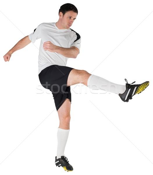 Futballista fehér rúg férfi futball fekete Stock fotó © wavebreak_media