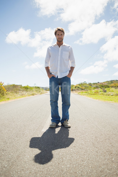 Handsome casual man standing on a road smiling at camera Stock photo © wavebreak_media