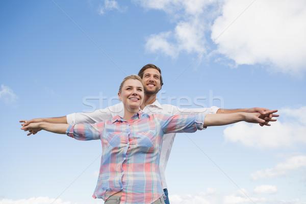 Boldog pár áll kívül karok nyújtott Stock fotó © wavebreak_media
