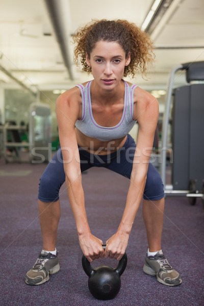 Fit woman squatting with kettlebell  Stock photo © wavebreak_media