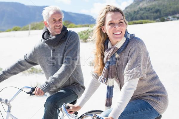 Carefree couple going on a bike ride on the beach  Stock photo © wavebreak_media