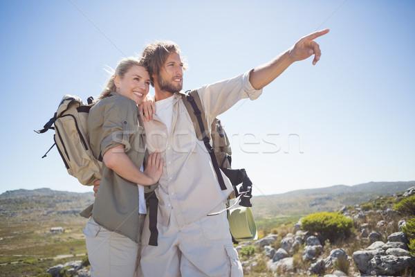 Randonnée couple permanent montagne terrain regarder Photo stock © wavebreak_media